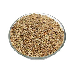 glass bowl full of hemp seeds isolated on white background
