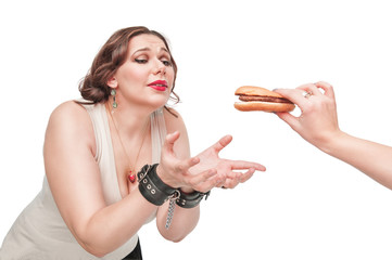 Plus size woman seduced with hamburger