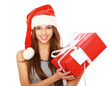 Christmas woman holding gift wearing Santa hat.