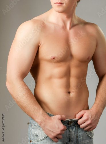 Strong man with a helathy body isolated over white background.