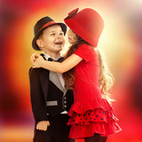 little boy and girl hugging