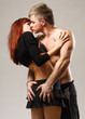 couple heterosexual topless with jeans detail studio shot.