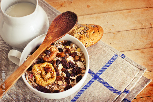 healthy breakfast background/ bowl of oat flake with raisins