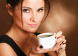 Portrait of a woman drinking coffee.