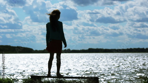 silhouette of a girl on the shore