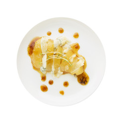 Baked pear, caramel, gorgonzola, thyme on plate, isolated