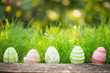 canvas print picture - Easter eggs on green grass