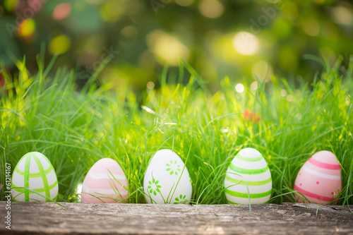 canvas print picture Easter eggs on green grass