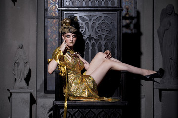 Sexy glamor lady sits on the throne