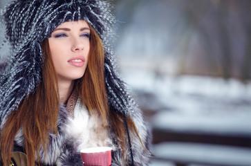 Woman Enjoying Hot Drink In Cafe