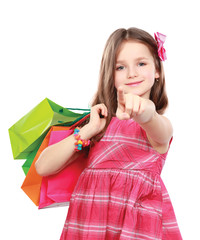 little girl with shopping bags pointing you