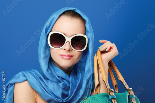 Portrait of an attractive young woman in sunglasses.