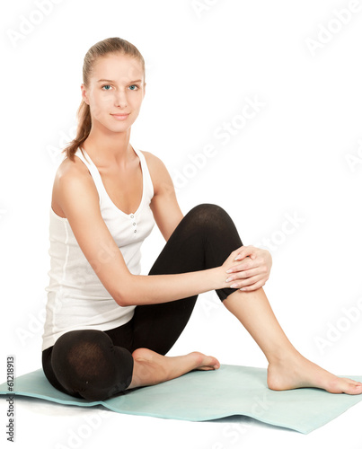 A sportive young girl sitting on the floor