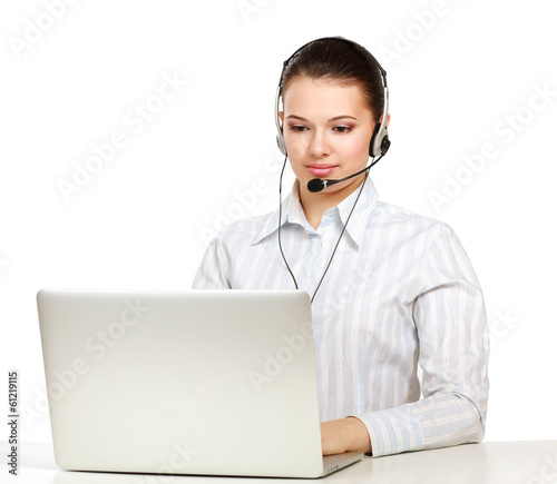 A young customer service girl with a headset at her workplace.
