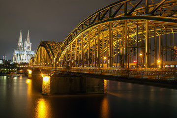 Night view of Hohenzollern Bridge and the cathedral in Cologne