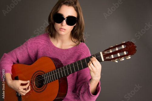 Blind woman playing acoustic guitar