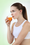 woman drinking orange juice vitamin