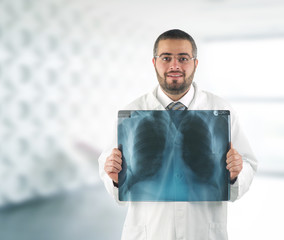 Doctor holding x-ray in front of his chest