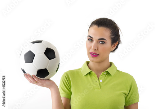 beautiful woman holding the football in her hand