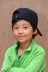 Cute boy with black cap smiling