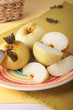 Sliced pickled apples on striped plate