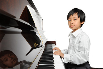 Young Asian boy playing piano
