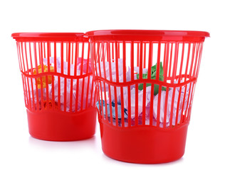 Two red garbage bins, isolated on white