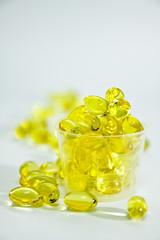 Fish oil capsule in the medicine cup