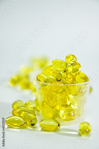 Fish oil capsule in the medicine cup
