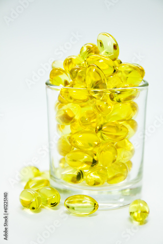 Fish oil capsule in the cup