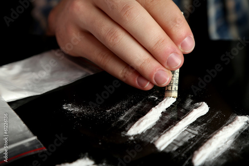 Man snorting cocaine, close up