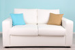 White sofa in room on blue background