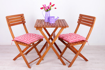 Garden chairs and table on white background