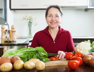 Mature woman in kitchen
