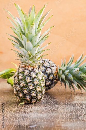 pineapple fruit on wood background