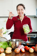 mature woman cooking lent diet soup with rice