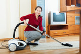 mature woman with vacuum cleaner
