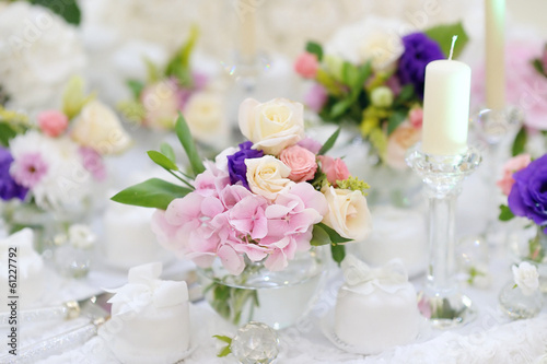Beautiful pink roses in small vases