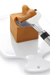 Scandinavian brown cheese and cutter