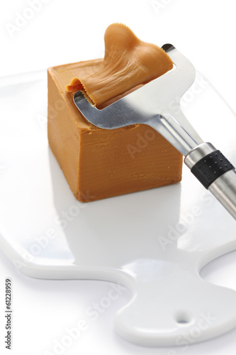 Scandinavian brown cheese and cutter