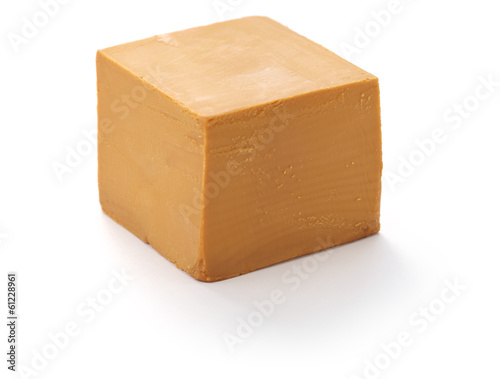 Scandinavian brown cheese isolated on white background