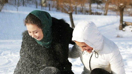 young girls playing with snow (throw)