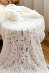 closeup detail of woven handicraft knit white sweater