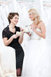 Shop assistant and the bride eat a pie