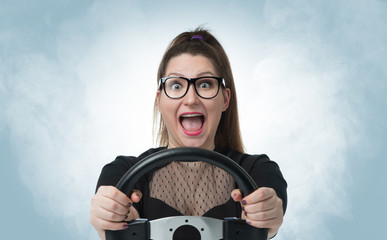 Funny girl in glasses with car wheel and white smoke