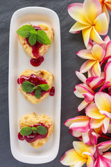 Cottage-cheese Baked Pudding in heart shape with frangipani flow