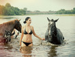 girl bathe horse in a river