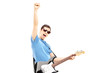 Happy guy playing on an electric guitar