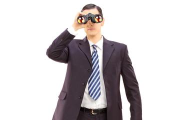 Male businessman watching through binoculars