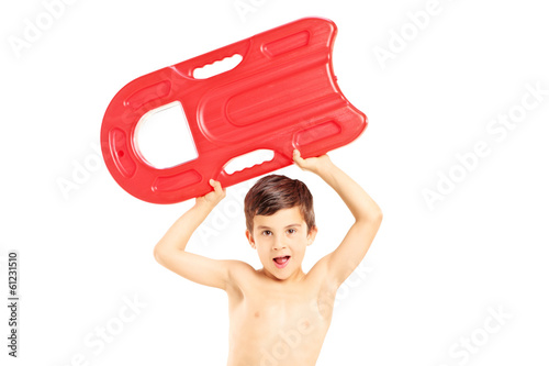 Boy holding a  swimming float and looking at camera